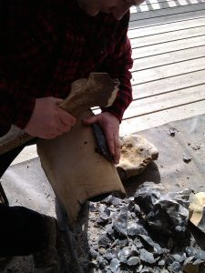 Making a handaxe during a demo at Nell Bank.